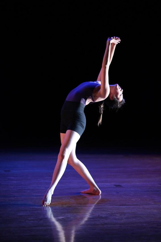 A woman leans back during a dance routine