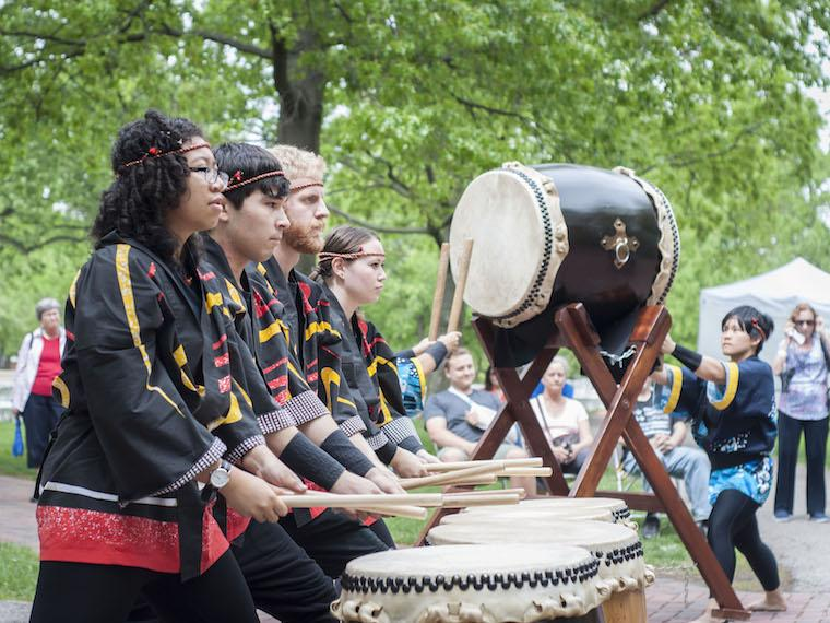 group of students in a line playing drums