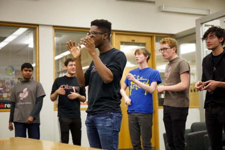 Students perform acapella in the library.