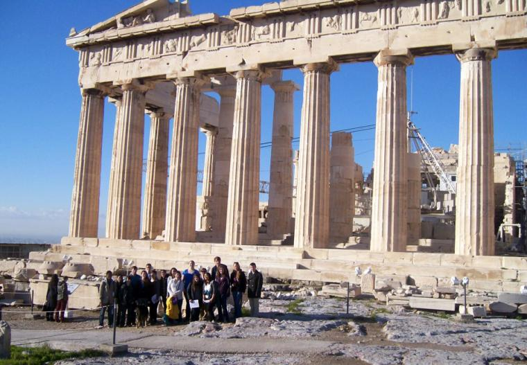 Group photograph of people standing in front of the Parthenon in Greece.